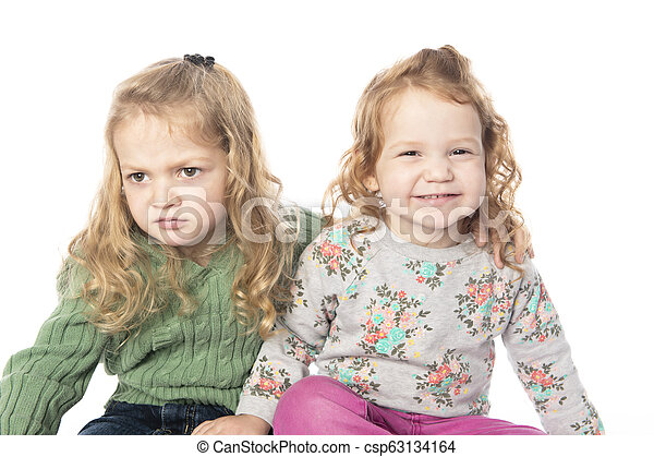 Cute sister Little Girl with redhead in studio white background - csp63134164