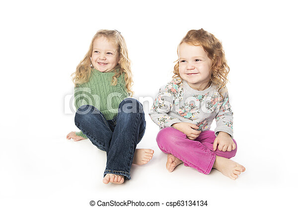 Cute sister Little Girl with redhead in studio white background - csp63134134
