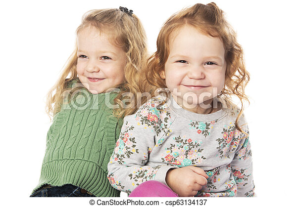 Cute sister Little Girl with redhead in studio white background - csp63134137