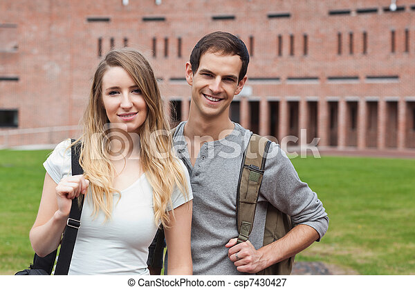 Cute student couple posing - csp7430427