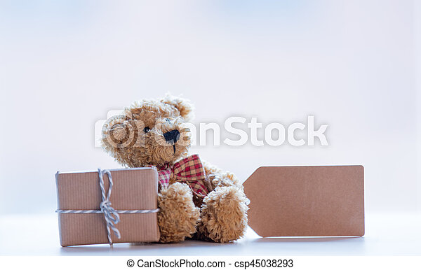 cute teddy bear with price tag and beautiful gift on the wonderful white background - csp45038293