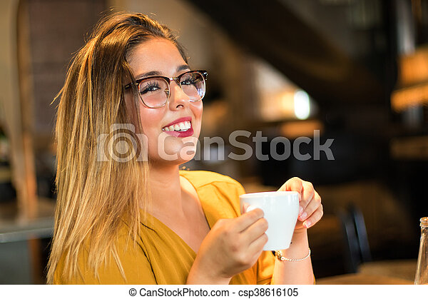 06f46d5d2204 Cute teen girl drinking coffee in restaurant. Close up portrait of ...