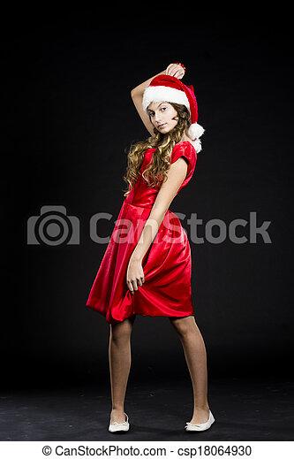 cute teen girl in santa claus costume - csp18064930