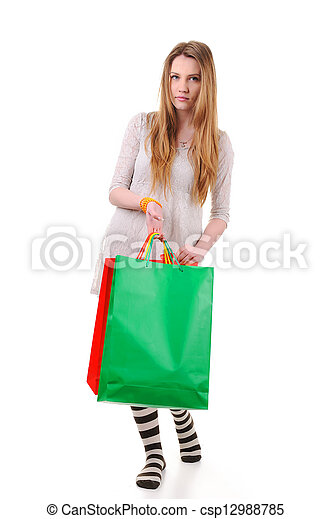 Cute teenage woman with shopping bags - csp12988785