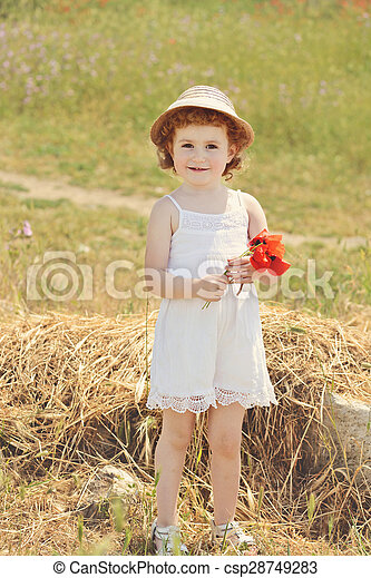 cute toddler with flowers - csp28749283