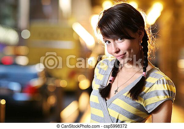 Cute woman in a city - csp5998372