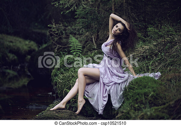 Cute woman in nature scenery - csp10521510
