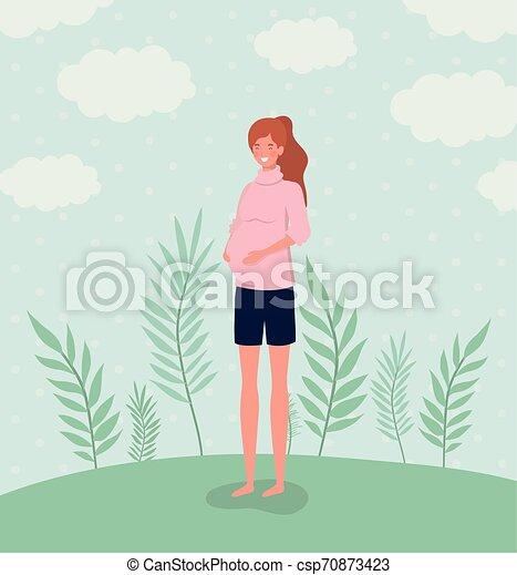 cute woman pregnancy in the landscape - csp70873423