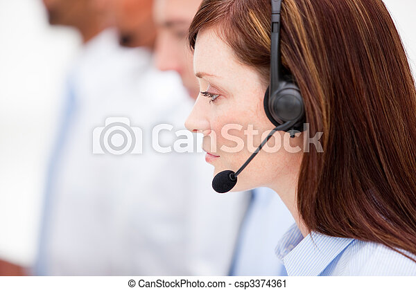 Cute woman working in a call center - csp3374361