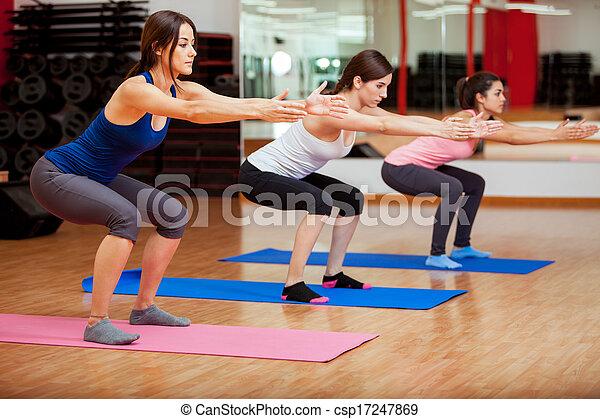 Cute women doing some squats - csp17247869