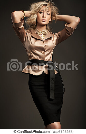 Cute young blond woman posing  - csp6745458