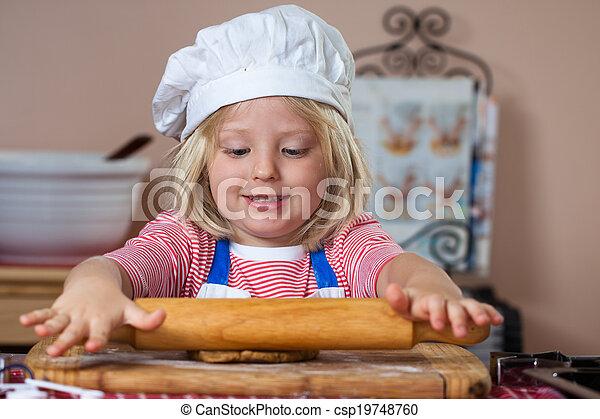 Cute young boy baking - csp19748760