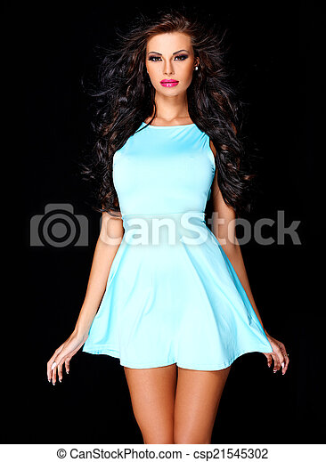 Cute young brunette posing in blue dress - csp21545302