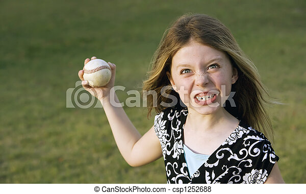 Cute young girl with a baseball - csp1252688
