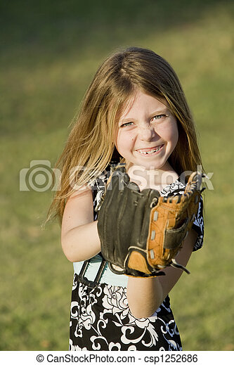 Cute young girl with a baseball - csp1252686