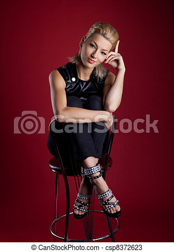 Cute young woman sit bar chair rock leather jacket - csp8372623