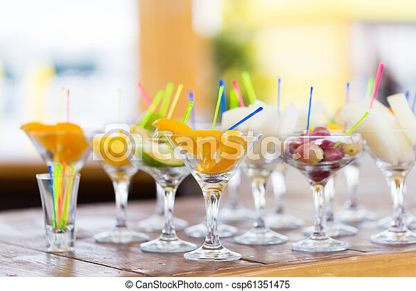 Cuts of fruits in glass for party - csp61351475
