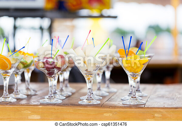 Cuts of fruits in glass for party - csp61351476