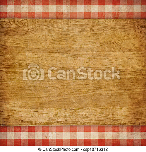 Cutting board over red grunge checked gingham picnic tablecloth background - csp18716312