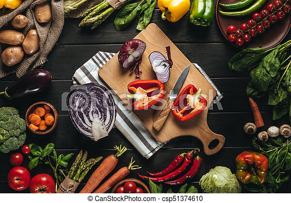 cutting board with fresh vegetables - csp51374610