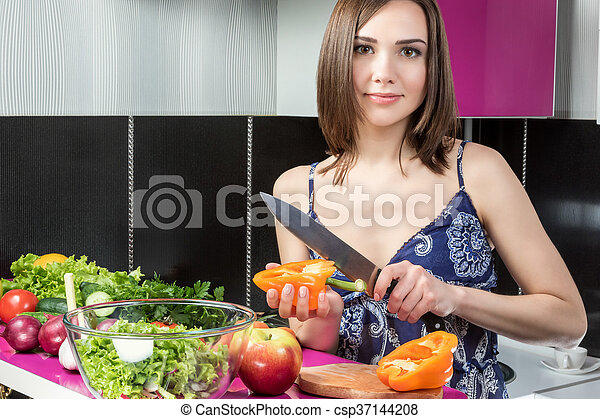 Cutting pepper in the kitchen - csp37144208