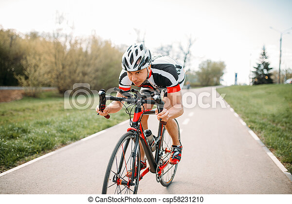 Cyclist in helmet and sportswear, bicycle training - csp58231210