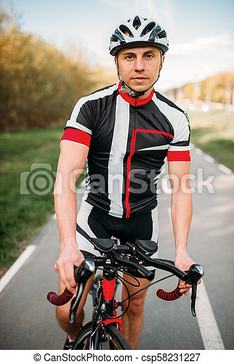 Cyclist in helmet and sportswear, bicycle training - csp58231227