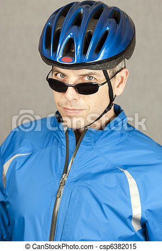 Cyclist Looks To Camera - csp6382015