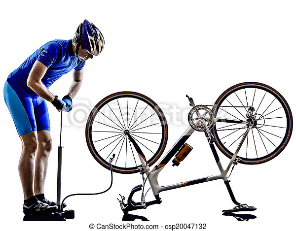 cyclist repairing bicycle silhouette - csp20047132