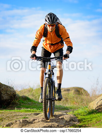 Cyclist Riding the Bike on the Beautiful Mountain Trail - csp17660254