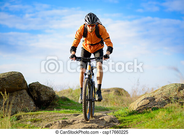 Cyclist Riding the Bike on the Beautiful Mountain Trail - csp17660225