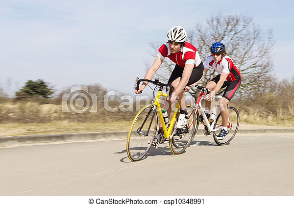 Cyclists Riding Cycles On Open Road - csp10348991