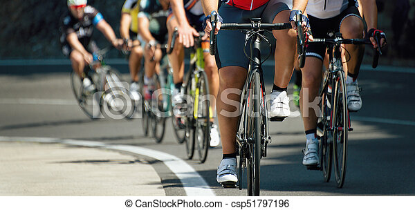 Cyclists with racing bikes during the cycling road race,when climbing uphill