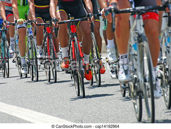 cyclists with sports during abbiglaimento during a challenging road bicycle race - csp14192864