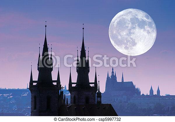 Czech Republic, Prague, silhouette of high section of Tyn church at night. - csp5997732