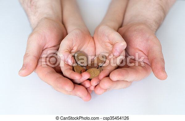 Dad and his daughter holding euro coins. - csp35454126
