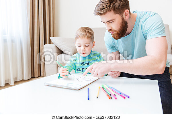 Dad and son drawing together at home - csp37032120