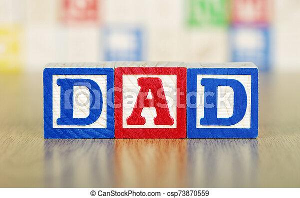 Dad Spelled Out in Alphabet Building Blocks - csp73870559