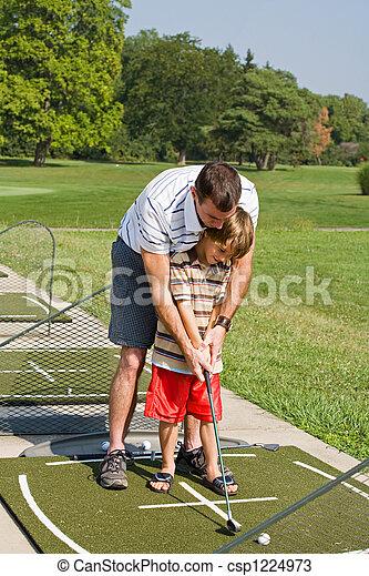 Dad Teaching Son Golf - csp1224973