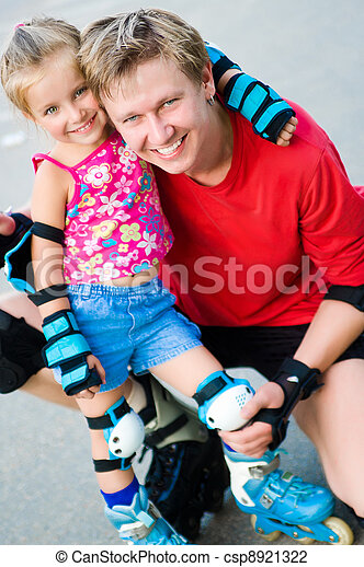 Dad with his daughter on the skates - csp8921322