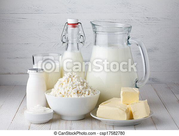 Dairy products, milk, cottage cheese, yogurt, sour cream and butter on wooden table - csp17582780