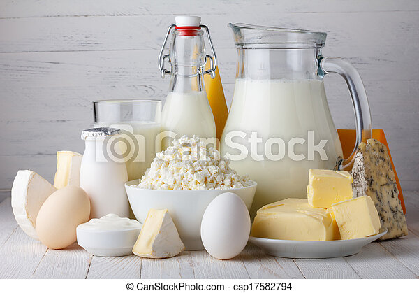 Dairy products, milk, cottage cheese, eggs, yogurt, sour cream and butter on wooden table - csp17582794
