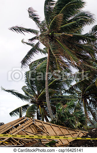 Damaged building during tropical storm  - csp16425141