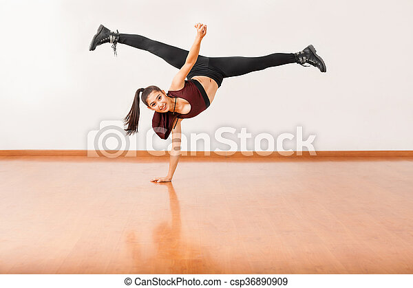 dancer doing a handstand with leg split beautiful female