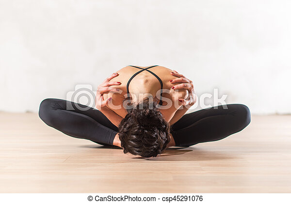 dancer doing advanced butterfly stretch exercise sitting