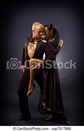 dancers against black background  - csp7517866