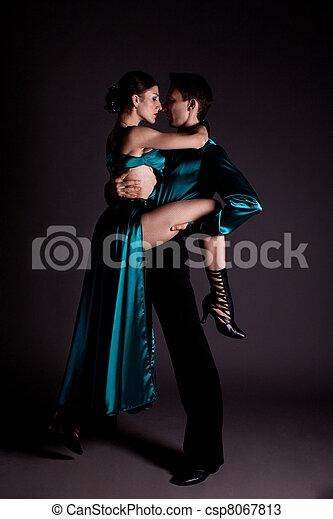 Dancers against black background - csp8067813