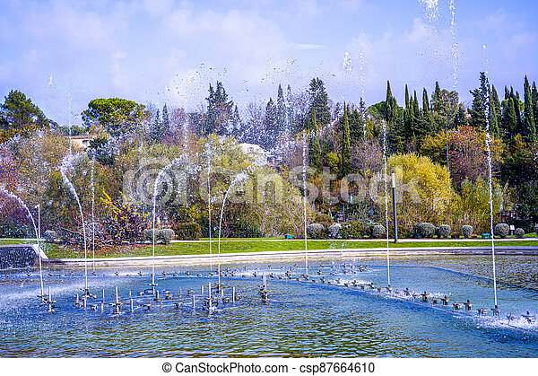 Dancing and singing fountains in the city park in France - csp87664610