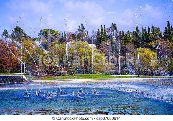 Dancing and singing fountains in the city park in France - csp87680614