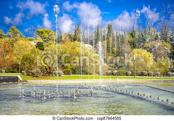 Dancing and singing fountains in the city park in France - csp87664585